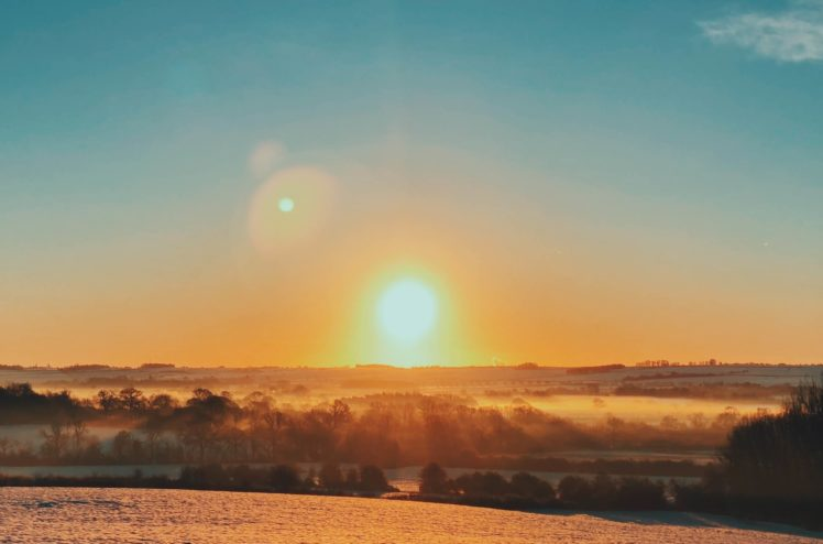 Image of sunrise over frosty countryside
