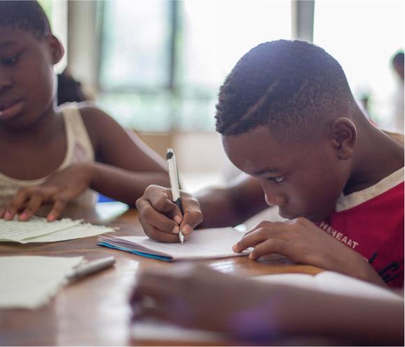 Image of boy writing