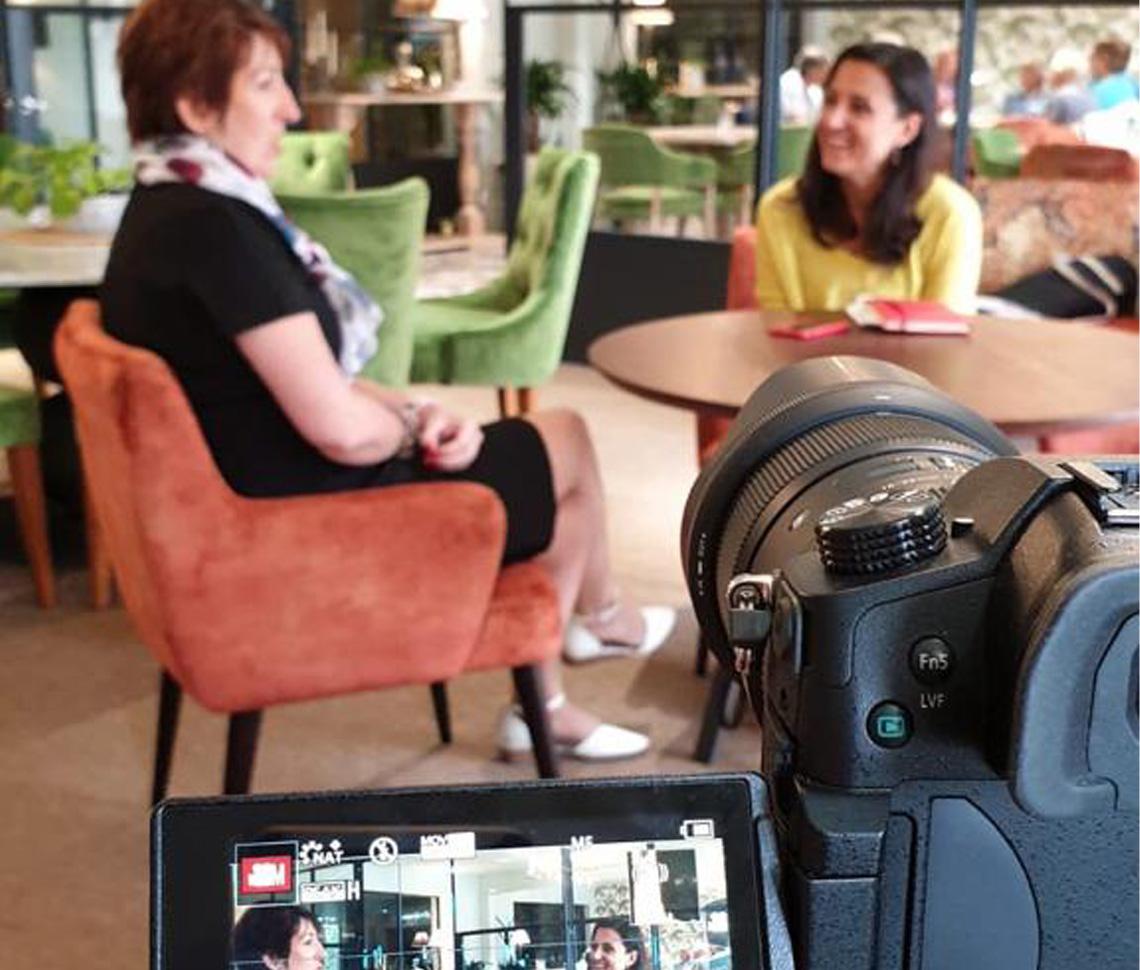 Image of interviewee being filmed