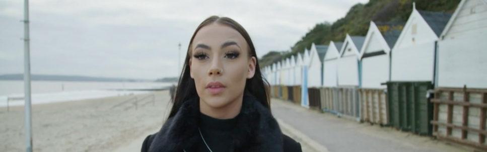 Image of lady walking along Bournemouth beachfront