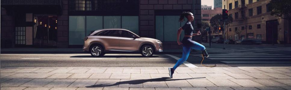 Image of Hyundai car and lady running with prosthetic leg