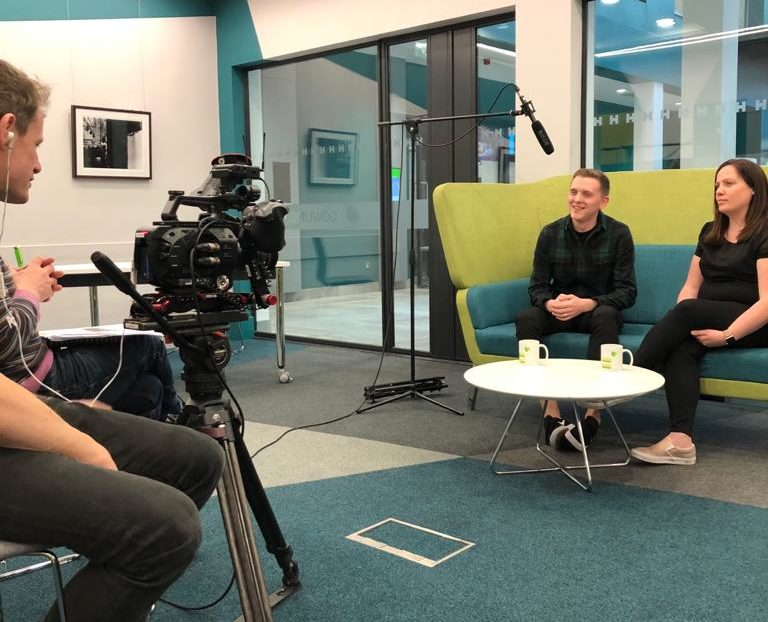 Image of interviewees being filmed