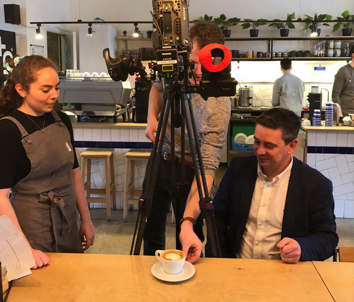 Photo of values film being filmed in coffee shop