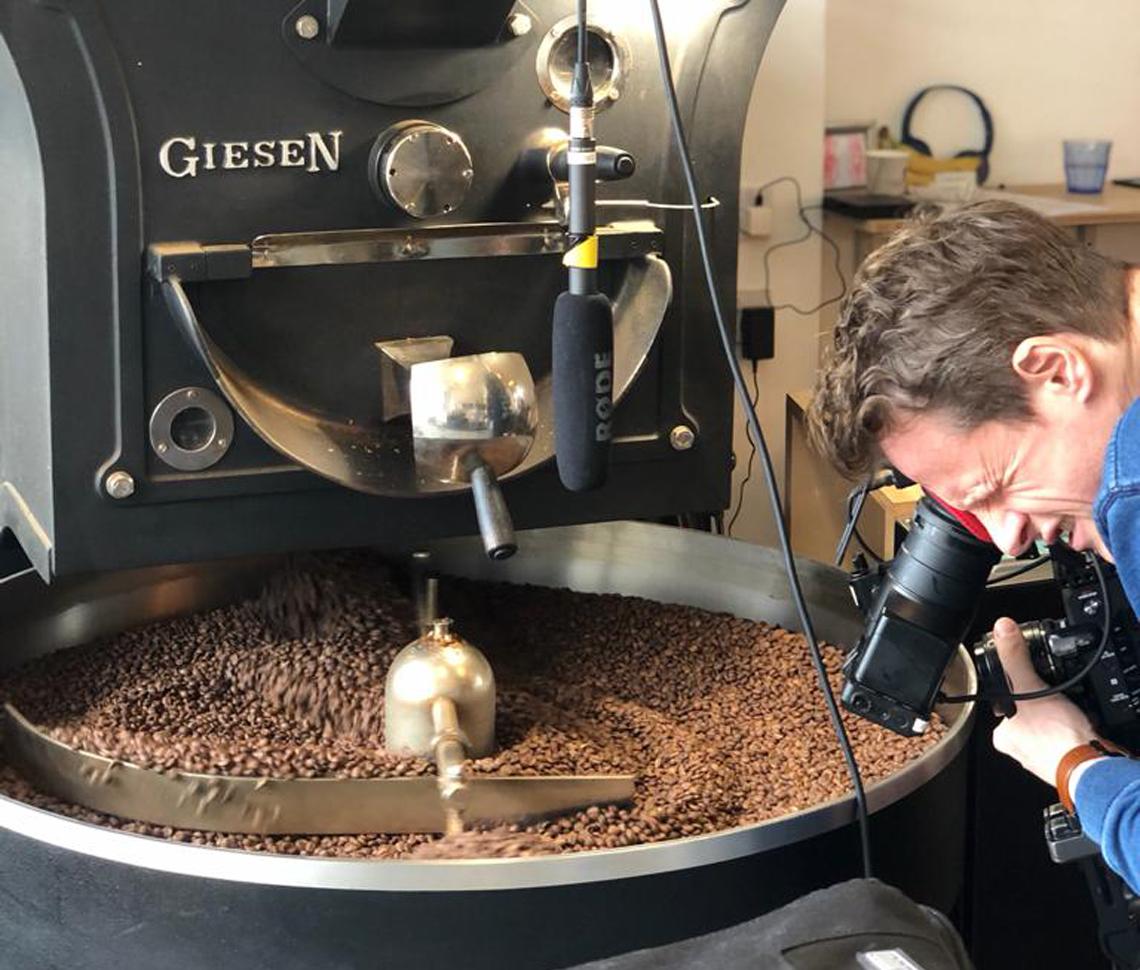 Image of cameraman filming coffee grinding