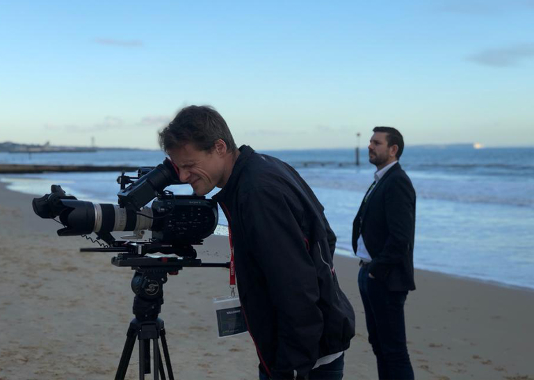 Photo of cameraman filming LV= GI welcome films